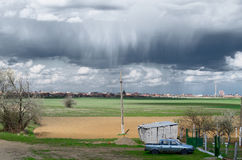 Approaching Storm. Storm clouds and rain approaching a park in the country Stock Image