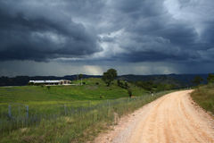 Approaching Storm. An approaching storm on a lonely country road and farmland, near Bullio, New South Wales, Australia Royalty Free Stock Photography