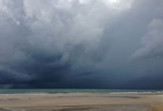 Approaching storm cloud with rain over the sea.  Royalty Free Stock Images
