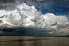 Approaching Storm Clouds Over Water Royalty Free Stock Images