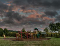 Approaching Storm. Empty playground in the evening as a storm approaches Royalty Free Stock Photography