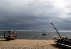Approaching storm, Fumba, Zanzibar, Africa. Early morning storm greets the fisherwomen of Fumba, Zanzibar stock photos