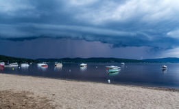 Approaching storm over the lake. St-Gabriel-de-Brandon, Québec, Сanada - July 30, 2014: Approaching rain storm clouds over the lake at St-Gabriel-de-Brandon Royalty Free Stock Images