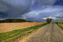 Approaching storm. Over the landscape in the fields Stock Photo