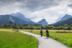 Approaching storm. Storm approaching riders on bicycle tour Stock Photography