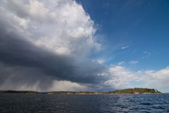 Approaching storm on a sea. Summer storm approaching during seakayaking around Stockholm Archipelago in summer time Royalty Free Stock Photo