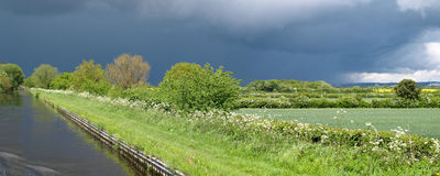 Approaching storm. View from a narrowboat on the Shropshire Union Canal Stock Photo