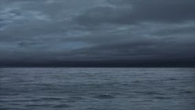 Approaching Storm. Waves under a dark cloudy sky stock footage