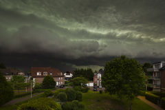 Approaching Thunderstorm Over Residential District. Spectacular cloud front of an upcoming thunderstorm turning day into night. The thunderstorm was one of the Royalty Free Stock Images