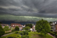 Approaching Thunderstorm Over Residential District Stock Photo