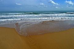 Approaching Tide On A Sandy Beach Royalty Free Stock Photo