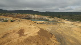 Approaching to abandoned slate mine hole with water stock footage