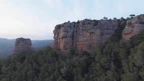 Approaching to high rocks in flat color stock footage