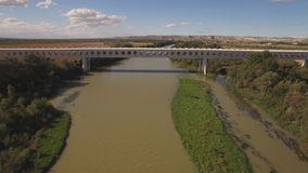 Approaching to modern train bridge over ebro river stock footage