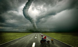 Approaching tornado. Large tornado over the road, approaching to toys(3D rendring Stock Photos