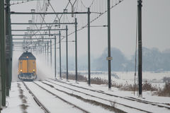 Approaching Train. A train approaches over a snow covered track Stock Photos
