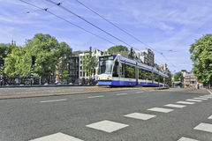 Approaching tram in Amsterdam city center, Netherlands. Royalty Free Stock Images