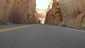 Approaching a tunnel by car on the Colorado National Monument. 4K vehicle mounted, stabilized clip of approaching a tunnel by car while visiting the Colorado stock video footage