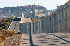 Approaching U.S. Border Patrol Vehicle at U.S./Mexico Border Wall. The international border wall between San Diego, California and Tijuana, Mexico, with an royalty free stock photography