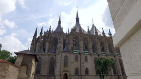 Approaching view of Saint Barbara Church, Roman Catholic church in Kutna Hora. In summer day stock video footage