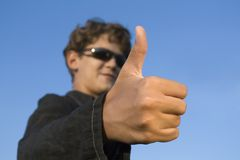 Approval. Gesture approval. Teenager out of focus Stock Photography