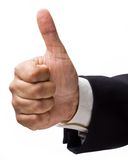 Approval sign. Businessman's hand showing the seal of approval royalty free stock photography