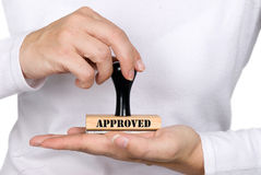 Approval Stamp and woman. A woman holding an approval stamp stock photo