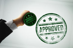 Approve a document with a green stamp Stock Images