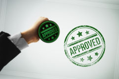 Approve a document with a green stamp Royalty Free Stock Images