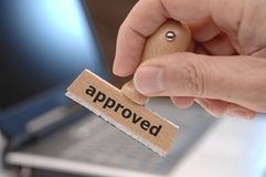 Approved. A stamp in an office with inscription approved royalty free stock photography