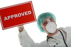 Approved. Portrait of senior doctor with approved table stock images