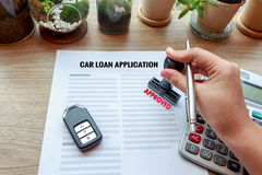 Approved car loan application with car key, rubber stamp and cal Stock Photography