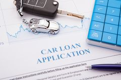 Approved car loan application form lay down on desk. Working royalty free stock image