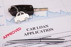 Approved car loan application form lay down on desk. Working Stock Photography