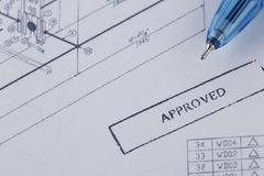 Approved engineering drawing documents with wrench. royalty free stock image