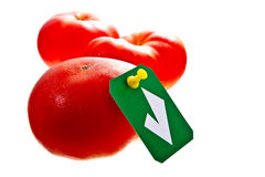 Approved fresh red tomatoes. Fresh red tomatoes isolated on white with a green check sign tag on it royalty free stock images