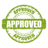 Approved green stamp with grunge on a white background Stock Photos
