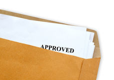 Approved letter. White paper with approved text in brown envelope royalty free stock images