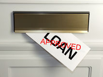 Approved Loan. A sign of economic recovery - an approved loan arrives in the post Royalty Free Stock Photos