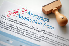 Approved mortgage application. Approved Mortgage loan application with rubber stamp royalty free stock photo