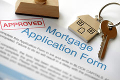 Approved mortgage application. Approved Mortgage loan application with house key and rubber stamp royalty free stock photos