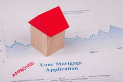Approved Mortgage Application on Desk. Working stock image