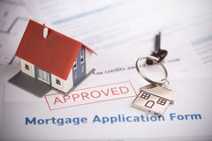 An approved Mortgage loan application form with house key and rubber stamp. Close up royalty free stock images