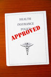 Approved policy. A health insurance policy, with Approved stamp Stock Photos