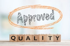Approved quality sign on a desk Stock Photo