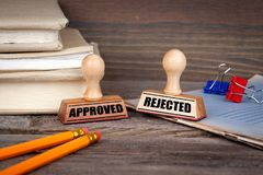 Approved and rejected. Rubber Stamp on desk in the Office. Business and work background royalty free stock images