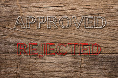 Approved and Rejected written on wooden background Stock Image