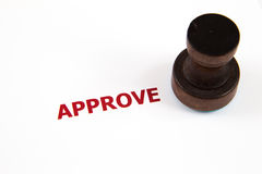 Approved on rubber stamp. Closeup of approved on rubber stamp Royalty Free Stock Photo