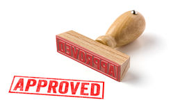 Approved. A rubber stamp on a white background - Approved royalty free stock photography