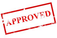 Approved stamp. A large stamp marking with the word Approved in red letters Stock Photography